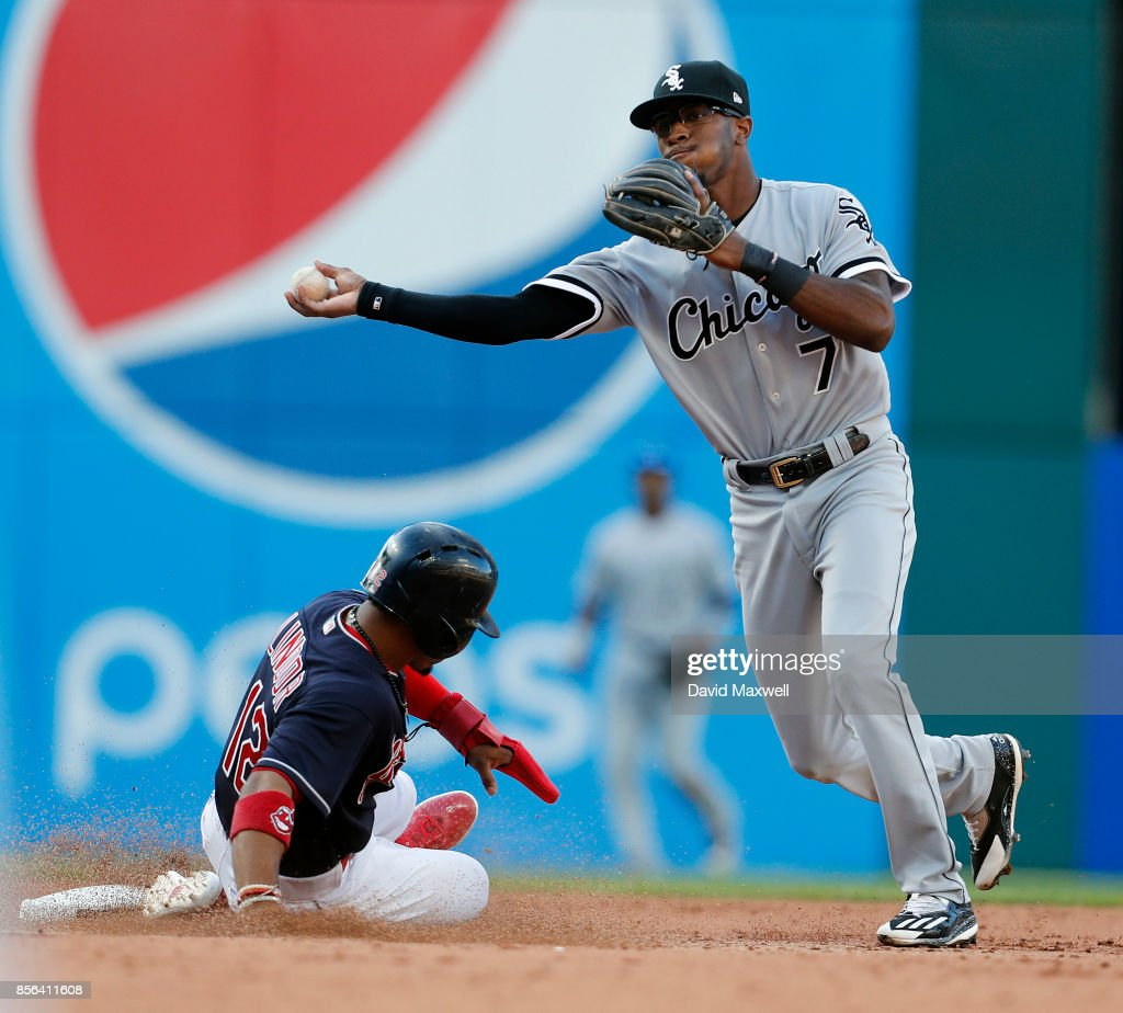 Francisco Lindor #12 of the Cleveland Indians is out at second base on a fielders choice as Tim Anderson #7 of the Chicago White Sox throws to first base in the seventh inning at Progressive Field on October 1, 2017 in Cleveland, Ohio. The Indians defeated the White Sox 3-1.
