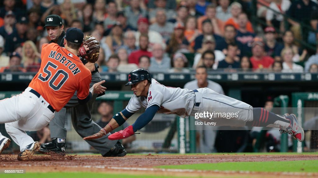 Francisco Lindor #12 of the Cleveland Indians is tagged out attempting to score by Charlie Morton #50 of the Houston Astros in the fifth inning at Minute Maid Park on May 19, 2017 in Houston, Texas.