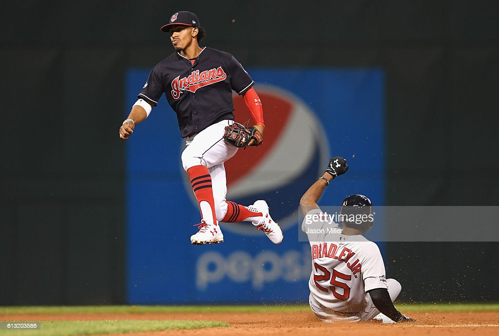 Francisco Lindor #12 of the Cleveland Indians jumps into the air after forcing out Jackie Bradley Jr. #25 of the Boston Red Sox at second base in the eighth inning during game two of the American League Divison Series at Progressive Field on October 7, 2016 in Cleveland, Ohio.