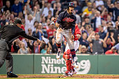 Francisco Lindor of the Cleveland Indians reacts after avoiding the tag of Christian Vazquez of the Boston Red Sox as he scores during the third...