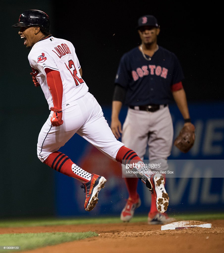 Francisco Lindor #12 of the Cleveland Indians reacts after hitting a home run against the Boston Red Sox in the third inning of game one of the American League Division Series on October 6, 2016 at Progressive Field in Cleveland, Ohio.