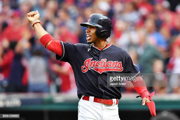 Francisco Lindor of the Cleveland Indians reacts after scoring on a hit by Carlos Santana in the first inning against the New York Yankees during...