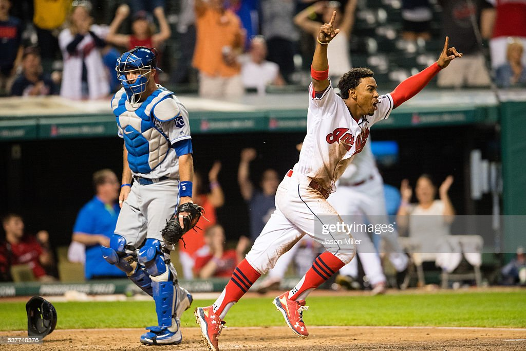 Francisco Lindor of the Cleveland Indians reacts after scoring the winning run as catcher Drew Butera of the Kansas City Royals walks to the dugout...