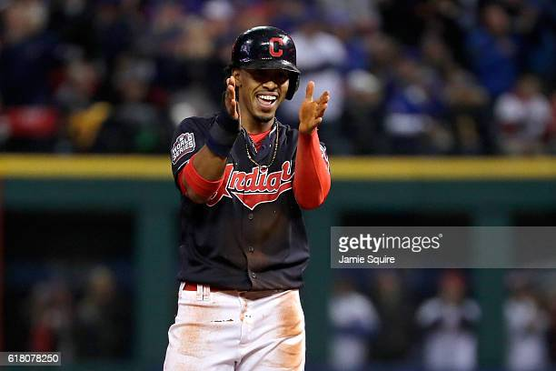 Francisco Lindor of the Cleveland Indians reacts after stealing second base in the first inning against Javier Baez of the Chicago Cubs in Game One...