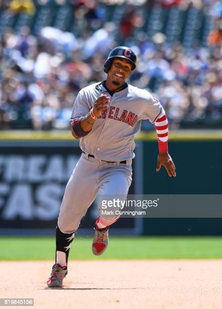 Francisco Lindor of the Cleveland Indians runs the bases while wearing a special red white and blue jersey arm sleeve and socks in honor of...