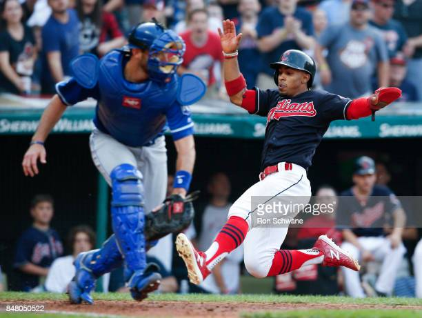 Francisco Lindor of the Cleveland Indians scores past Drew Butera of the Kansas City Royals on a single by Austin Jackson during the sixth inning at...