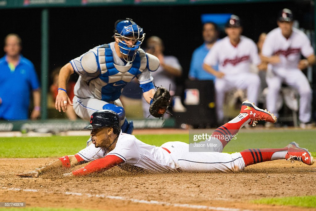 Francisco Lindor #12 of the Cleveland Indians scores the winning run on a sacrifice fly by Mike Napoli ahead of the tag by catcher Drew Butera #9 of the Kansas City Royals at Progressive Field on June 2, 2016 in Cleveland, Ohio. The Indians defeated the Royals 5-4.