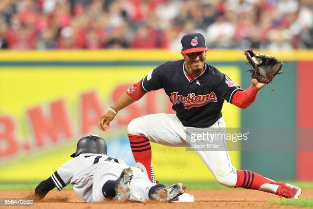 Francisco Lindor of the Cleveland Indians tags Ronald Torreyes of the New York Yankees out in the eleventh inning during game two of the American...
