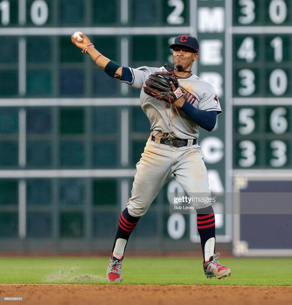 Francisco Lindor #12 of the Cleveland Indians throws out Jose Altuve #27 of the Houston Astros in the sixth inning at Minute Maid Park on May 19, 2017 in Houston, Texas.