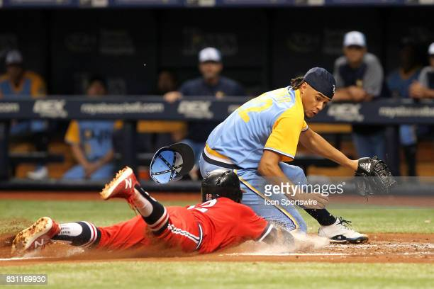 Francisco Lindor of the Indians slides safely home as Chris Archer of the Rays is late in applying the tag during the MLB regular season game between...