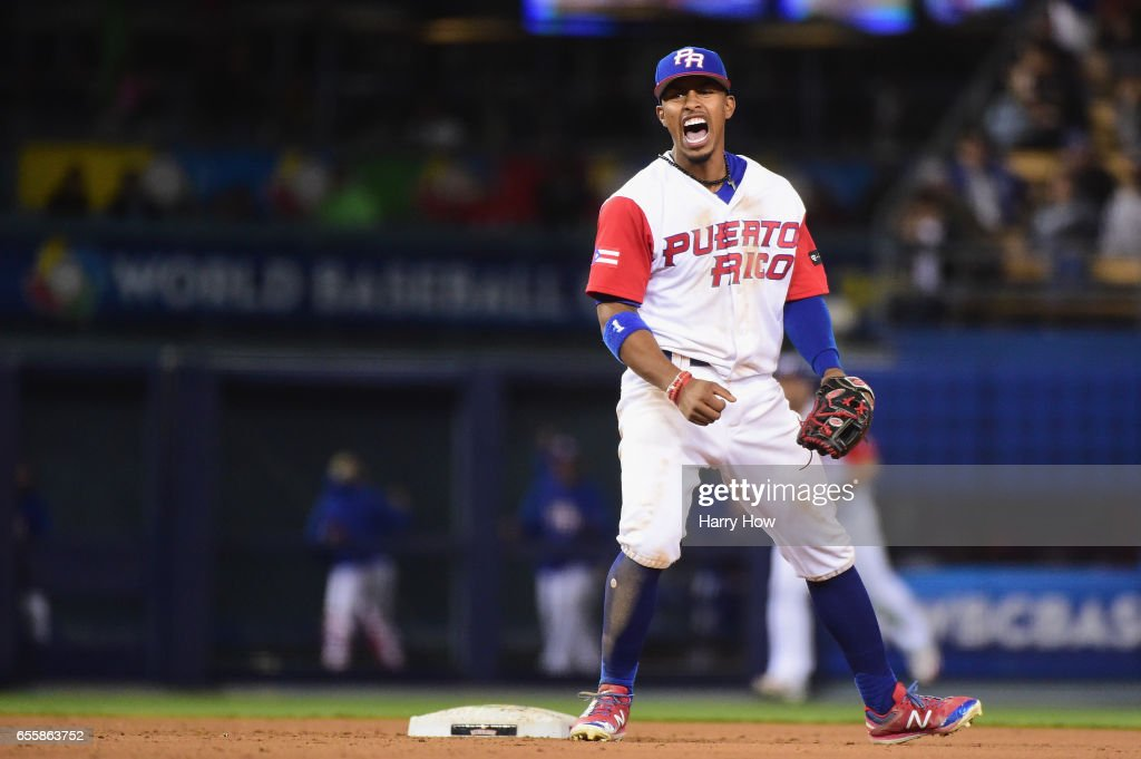 Francisco Lindor #12 of the Puerto Rico celebrates an inning-ending double play against team Netherlands during Game 1 of the Championship Round of the 2017 World Baseball Classic at Dodger Stadium on March 20, 2017 in Los Angeles, California.