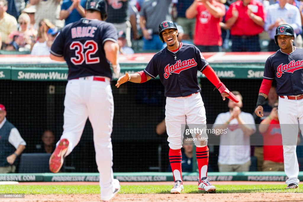 Francisco Lindor #12 waits to celebrate with Jay Bruce #32 of the Cleveland Indians after both scored during the first inning on a home run by Bruce at Progressive Field on September 13, 2017 in Cleveland, Ohio.