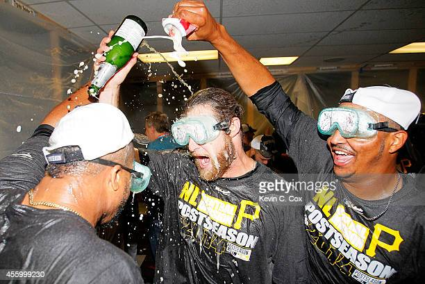 Francisco Liriano John Axford and Stolmy Pimentel of the Pittsburgh Pirates celebrate clinching a National League playoff spot after their 32 win...