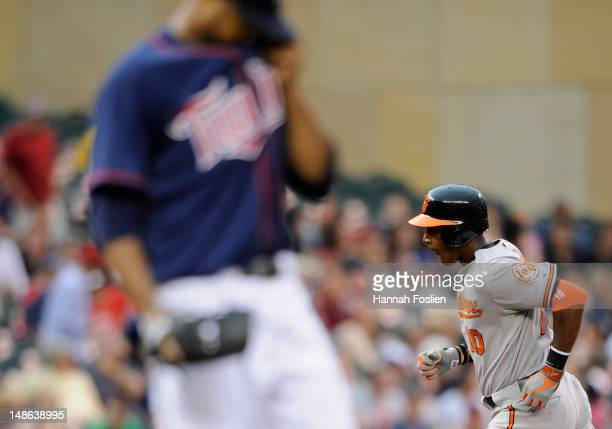 Francisco Liriano of the Minnesota Twins looks on as Adam Jones of the Baltimore Orioles rounds the bases after a tworun home run during the first...