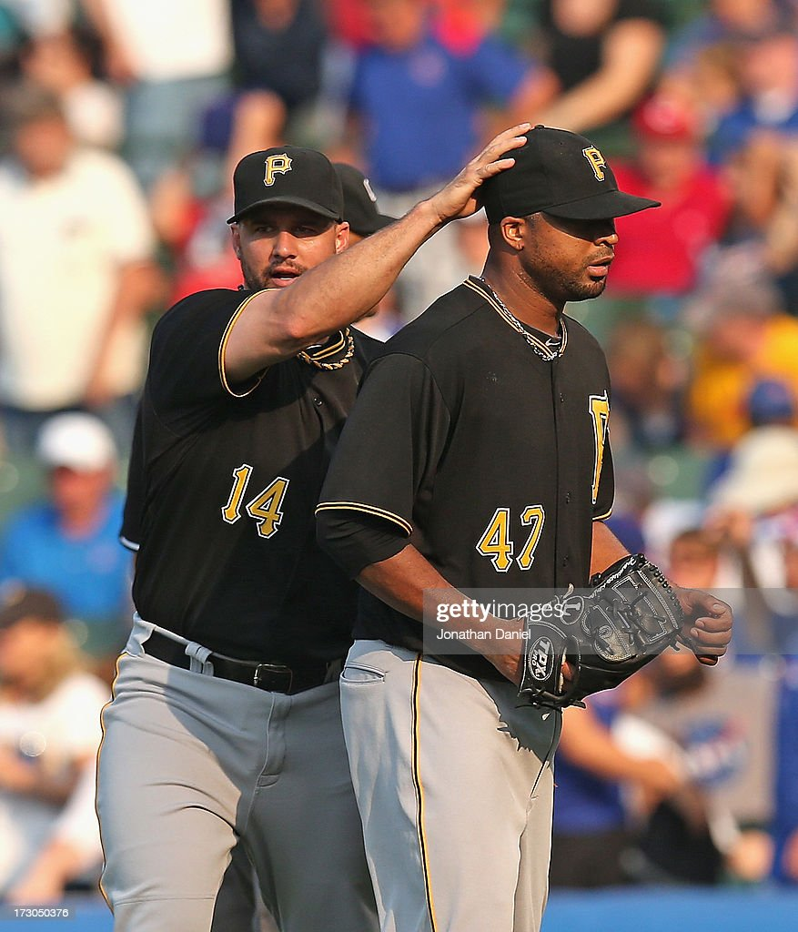 <a gi-track='captionPersonalityLinkClicked' href=/galleries/search?phrase=Francisco+Liriano&family=editorial&specificpeople=580400 ng-click='$event.stopPropagation()'>Francisco Liriano</a> #47 of the Pittsburgh Pirates gets a pat on the head from <a gi-track='captionPersonalityLinkClicked' href=/galleries/search?phrase=Gaby+Sanchez&family=editorial&specificpeople=4945789 ng-click='$event.stopPropagation()'>Gaby Sanchez</a> #14 after a compete game win against the Chicago Cubs at Wrigley Field on July 5, 2013 in Chicago, Illinois. The Pirates defeated the Cubs 6-2.