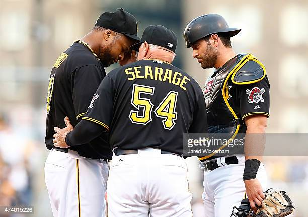 Francisco Liriano of the Pittsburgh Pirates is visited at the mound by pitching coach Ray Searage and Francisco Cervelli in the second inning against...