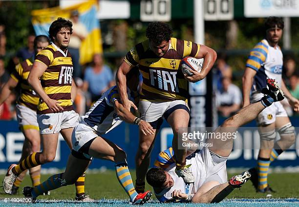 Francisco Mari of Belgrano Athletic breaks free from a tackle by Agustin Schab of Hindu during a match between Belgrano Athletic and Hindu Club as...