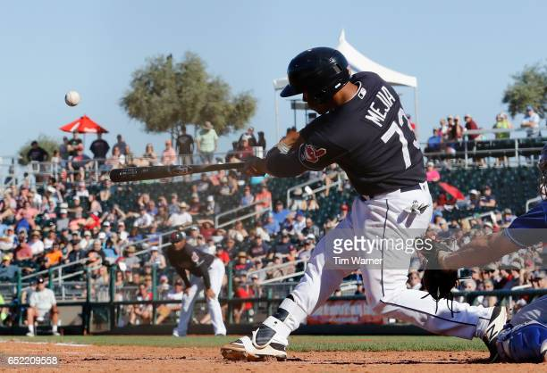 Francisco Mejia of the Cleveland Indians hits a grand slam in the seventh inning against the Kansas City Royals during the spring training game at...