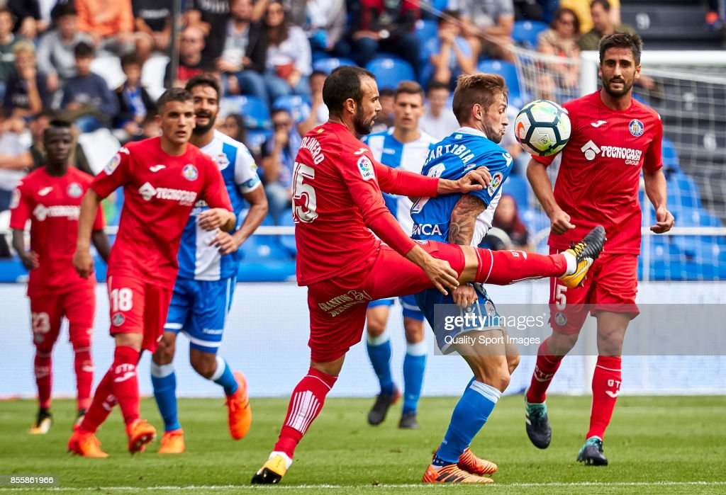 Francisco Molinero of Getafe CF competes for the ball with Fede Cartabria of Deportivo de La Coruna during the La Liga match between Deportivo La Coruna and Getafe at Abanca Riazor Stadium on September 30, 2017 in La Coruna, Spain.