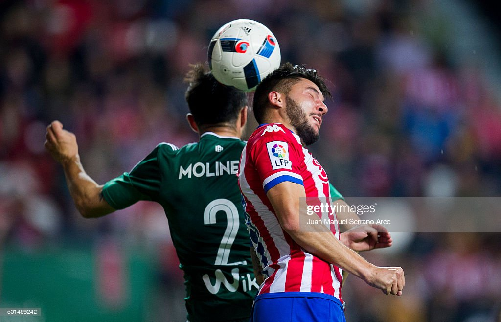 Francisco Molinero of Real Betis Balompie duels for the ball with Miguel Guerrero of Real Sporting de Gijon during the Copa del Rey Round of 32 match between Real Sporting de Gijon and Real Betis Balompie at Estadio El Molinon on December 15, 2015 in Gijon, Spain.
