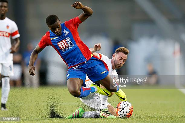 Francisco Narbon of FC Cincinnati tackles Pape Souare of Crystal Palace FC during the second half at Nippert Stadium on July 16 2016 in Cincinnati...