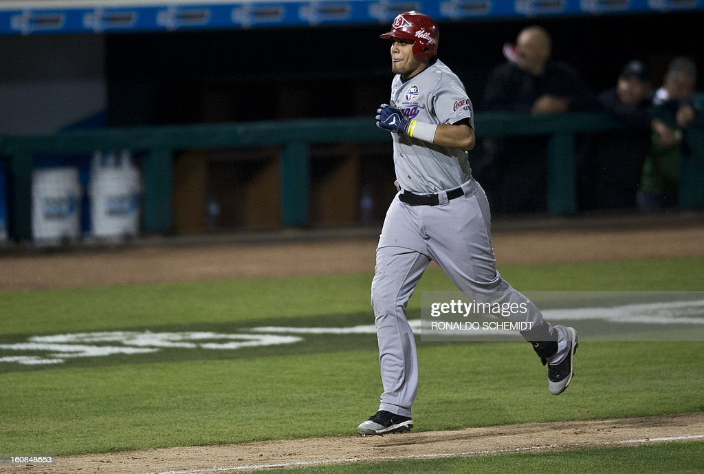 Francisco Peña of Leones del Escogido of Dominican Republic, runs after his home run against Magallanes of Venezuela, during the 2013 Caribbean baseball series, on February 6, 2013, in Hermosillo, Sonora State, in the northern of Mexico. AFP PHOTO/Ronaldo Schemidt