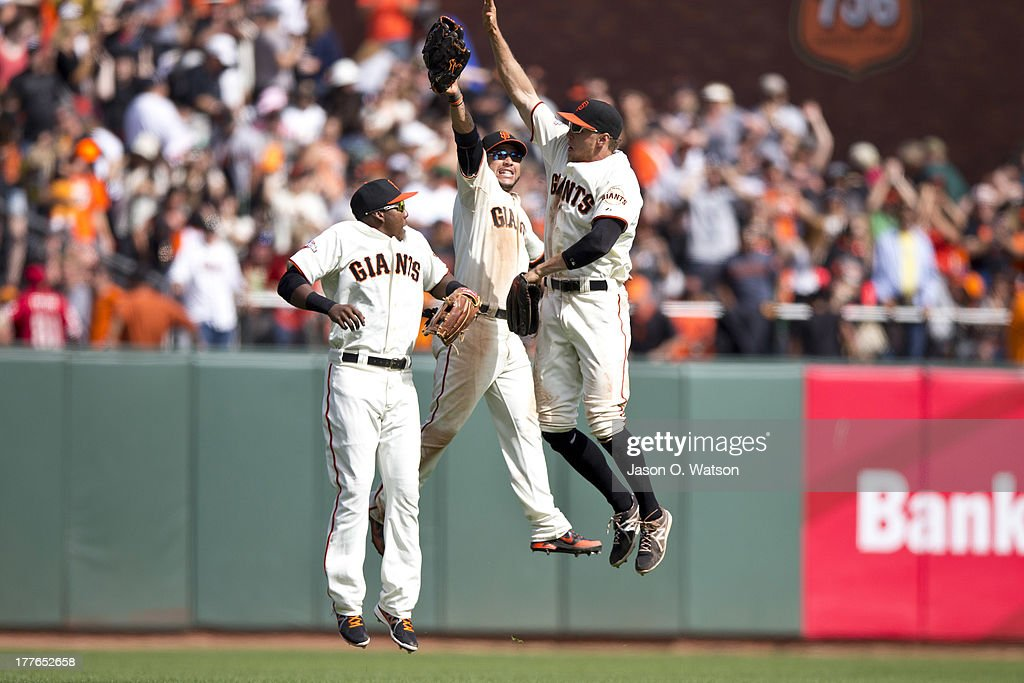 Francisco Peguero #14 of the San Francisco Giants, <a gi-track='captionPersonalityLinkClicked' href=/galleries/search?phrase=Gregor+Blanco&family=editorial&specificpeople=4137600 ng-click='$event.stopPropagation()'>Gregor Blanco</a> #7 and <a gi-track='captionPersonalityLinkClicked' href=/galleries/search?phrase=Hunter+Pence&family=editorial&specificpeople=757341 ng-click='$event.stopPropagation()'>Hunter Pence</a> #8 celebrate after the game against the Pittsburgh Pirates at AT&T Park on August 25, 2013 in San Francisco, California. The San Francisco Giants defeated the Pittsburgh Pirates 4-0.