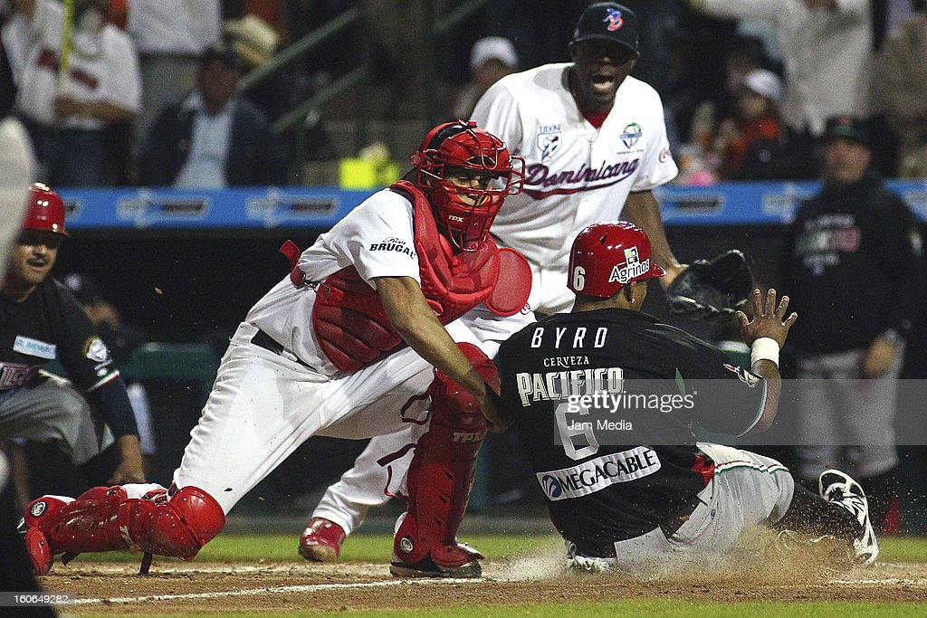 Francisco Pena of Republica Dominicana and Marlon Byrd of Mexico in action during the Caribbean Series Baseball 2013 in Sonora Stadium on February 2, 2013 in Hermosillo, Mexico.