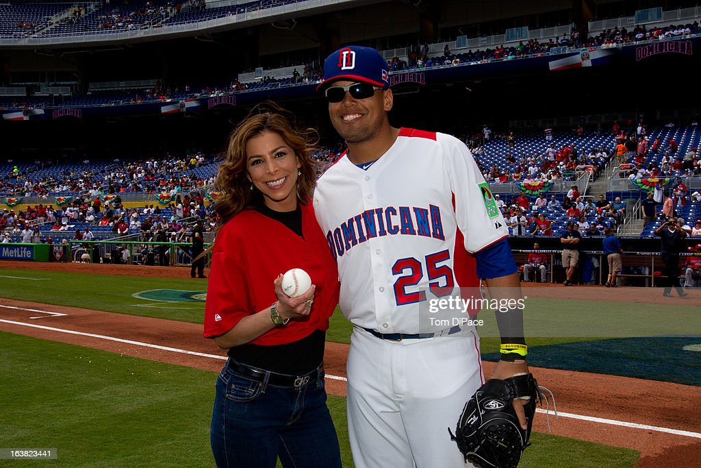 Francisco Pena #25 of Team Dominican Republic and Lourdes Stephen, Univision Crrespondent and Host of 'Sal y Pimiento' pose for a photo on the field before Pool 2, Game 6 against Team Puerto Rico in the second round of the 2013 World Baseball Classic on Saturday, March 16, 2013 at Marlins Park in Miami, Florida.