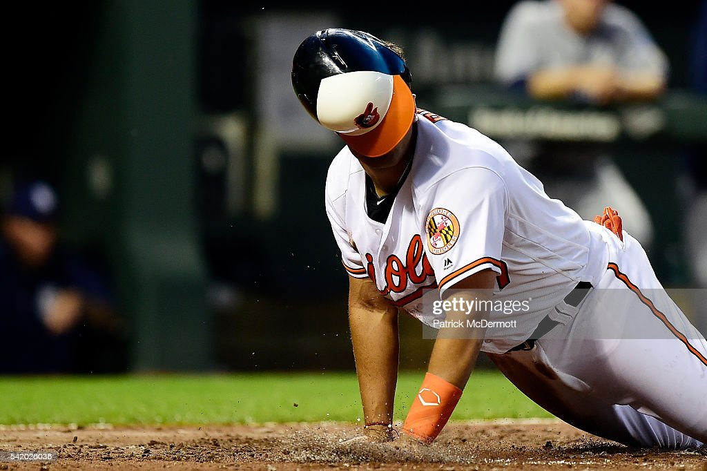 Francisco Pena of the Baltimore Orioles scores on a double hit by Adam Jones in the third inning during a MLB baseball game against the San Diego...