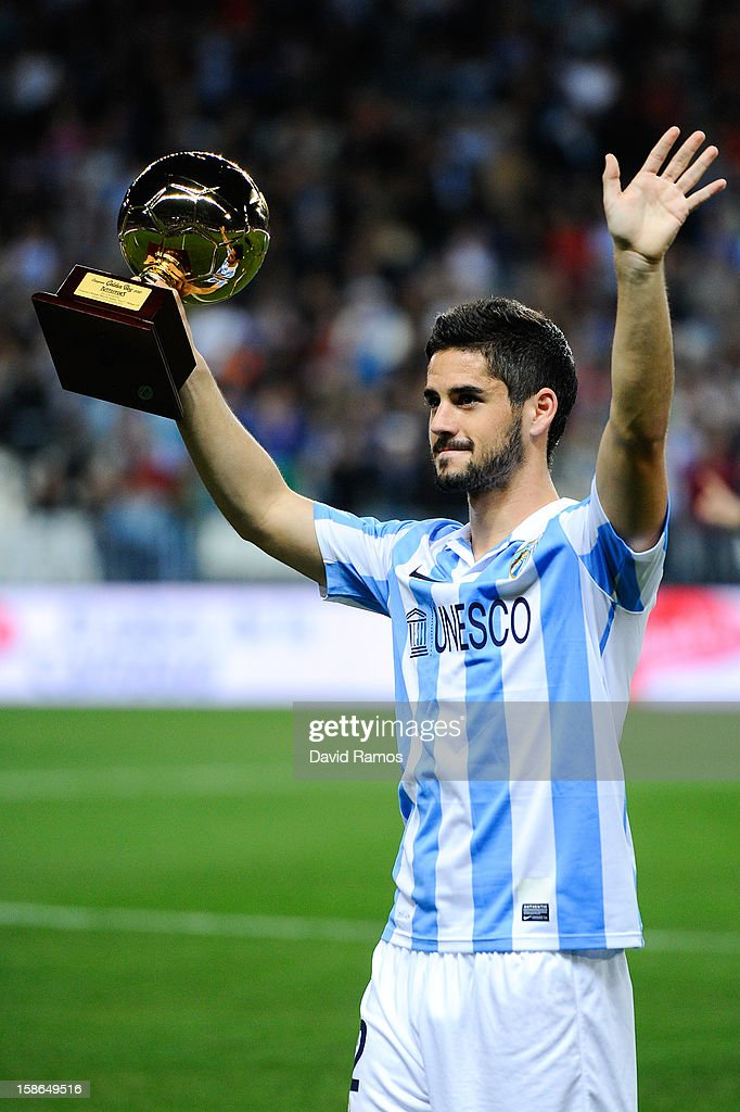 Francisco R. Alarcon Isco of Malaga CF holds up the 'Golen boy' trophy for being the best U-21 European player given by the sports daily newspaper Tuttosport prior to the La Liga match between Malaga CF and Real Madrid CF at La Rosaleda Stadium on December 22, 2012 in Malaga, Spain.