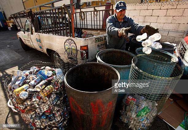 Francisco Rios sorts through the cans plastic and glassware he brought to Chris Recycling Center located at Central and 11th streets in Los Angeles...