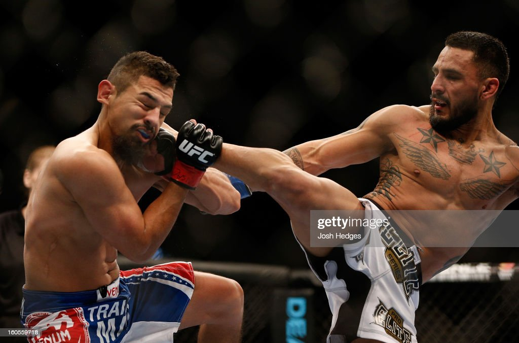 Francisco Rivera kicks Edwin Figueroa during their bantamweight fight at UFC 156 on February 2, 2013 at the Mandalay Bay Events Center in Las Vegas, Nevada.