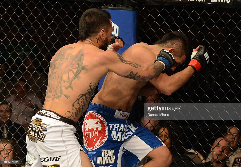 Francisco Rivera punches Edwin Figueroa during their bantamweight fight at UFC 156 on February 2, 2013 at the Mandalay Bay Events Center in Las Vegas, Nevada.