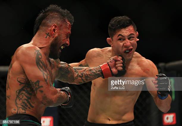 Francisco Rivera punches Erik Perez of Mexico in their bantamweight bout during the UFC 201 event on July 30 2016 at Philips Arena in Atlanta Georgia