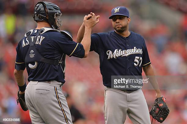 Francisco Rodriguez and Nevin Ashley both of the Milwaukee Brewers celebrate after defeating the St Louis Cardinals 84 at Busch Stadium on September...