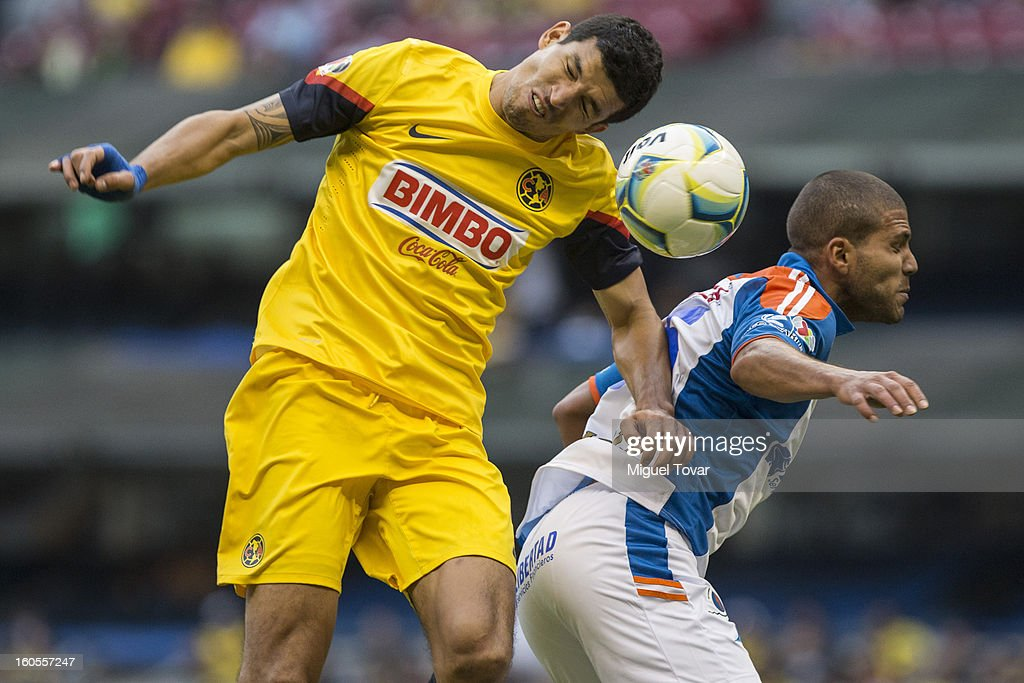 Francisco Rodriguez of America fights for the ball with Oswaldo Enriquez of Queretaro during a Clausura 2013 Liga MX match at Azteca Stadium on February 02, 2013 in Mexico City, Mexico.