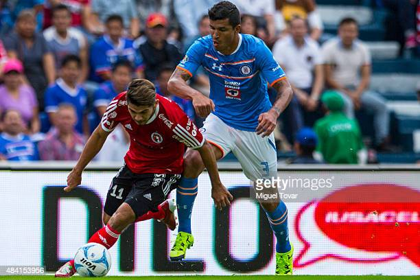 Francisco Rodriguez of Cruz Azul fights for the ball with Henry Martin of Tijuana during a 5th round match between Cruz Azul and Tijuana as part of...