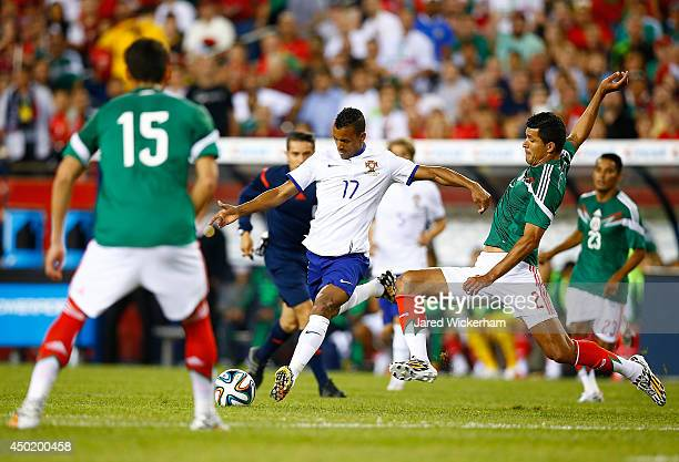 Francisco Rodriguez of Mexico defends the shot by Nani of Portugal in the first half during the international friendly match at Gillette Stadium on...