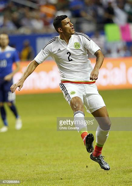 Francisco Rodriguez of Mexico watches his kick against the United States during an international friendly match at the Alamodome on April 15 2015 in...