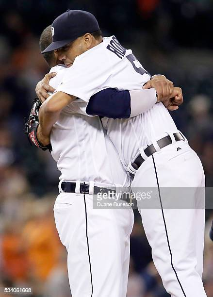 Francisco Rodriguez of the Detroit Tigers receives a hug from Victor Martinez of the Detroit Tigers after recording his 400th career save in a 31 win...