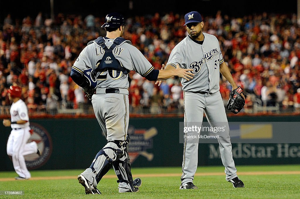 Francisco Rodriguez #57 of the Milwaukee Brewers celebrates with <a gi-track='captionPersonalityLinkClicked' href=/galleries/search?phrase=Jonathan+Lucroy&family=editorial&specificpeople=5732413 ng-click='$event.stopPropagation()'>Jonathan Lucroy</a> #20 after the Brewers defeated the Washington Nationals 4-1 during a game at Nationals Park on July 3, 2013 in Washington, DC.