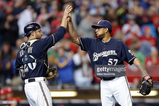 Francisco Rodriguez of the Milwaukee Brewers celebrates with Jonathan Lucroy after the 51 win over the St Louis Cardinals at Miller Park on April 16...