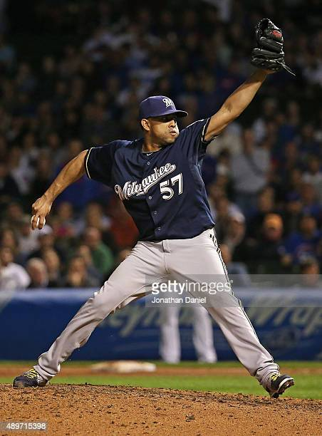 Francisco Rodriguez of the Milwaukee Brewers pitches in the 9th inning for his 35th save of the season against the Chicago Cubs at Wrigley Field on...