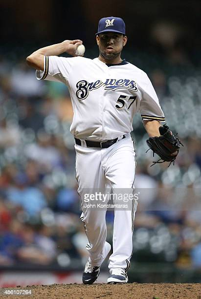 Francisco Rodriguez of the Milwaukee Brewers throws to first base during the ninth inning against the Cincinnati Reds at Miller Park on August 29...