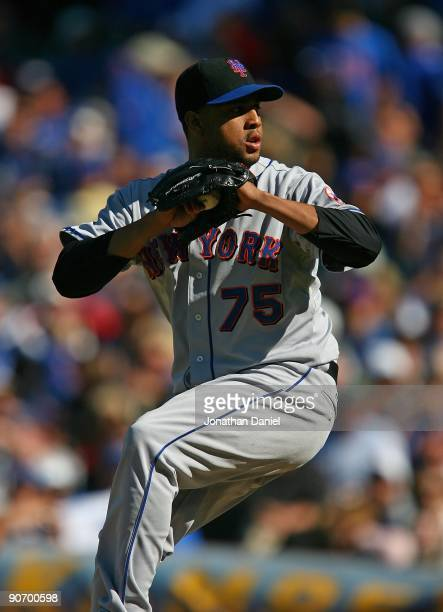 Francisco Rodriguez of the New York Mets pitches in the 9th inning against the Chicago Cubs on August 30 2009 at Wrigley Field in Chicago Illinois...