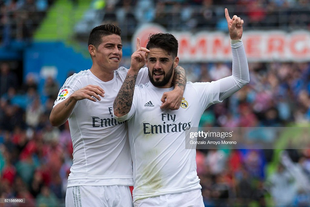 Francisco Roman Alarcon alias <a gi-track='captionPersonalityLinkClicked' href=/galleries/search?phrase=Isco&family=editorial&specificpeople=5848609 ng-click='$event.stopPropagation()'>Isco</a> (R) of Real Madrid CF celebrates scoring their second goal with teammate <a gi-track='captionPersonalityLinkClicked' href=/galleries/search?phrase=James+Rodriguez&family=editorial&specificpeople=4422074 ng-click='$event.stopPropagation()'>James Rodriguez</a> (L) during the La Liga match between Getafe CF and Real Madrid CF at Coliseum Alfonso Perez on April 16, 2016 in Getafe, Spain.