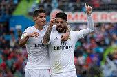 Francisco Roman Alarcon alias Isco of Real Madrid CF celebrates scoring their second goal with teammate James Rodriguez during the La Liga match...