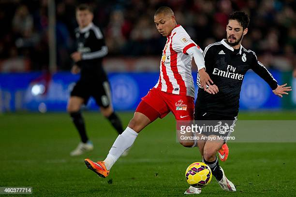 Francisco Roman Alarcon alias Isco of Real Madrid CF competes for the ball with Wellington Silva of Almeria UD during the La Liga match between UD...