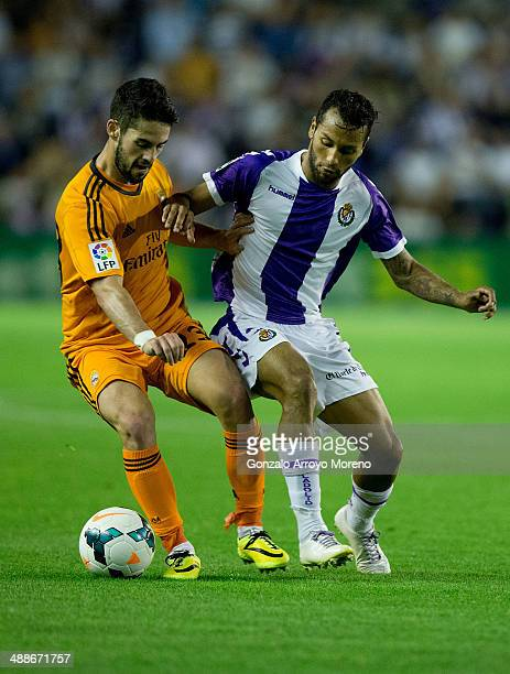 Francisco Roman Alarcon alias Isco of Real Madrid CF competes for the ball with Jeffren Suarez of Real Valladolid CF during the La Liga match between...
